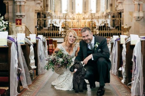 Joan and Andrew with their dog at their wedding by gloucestershire wedding photographer amber marie photography