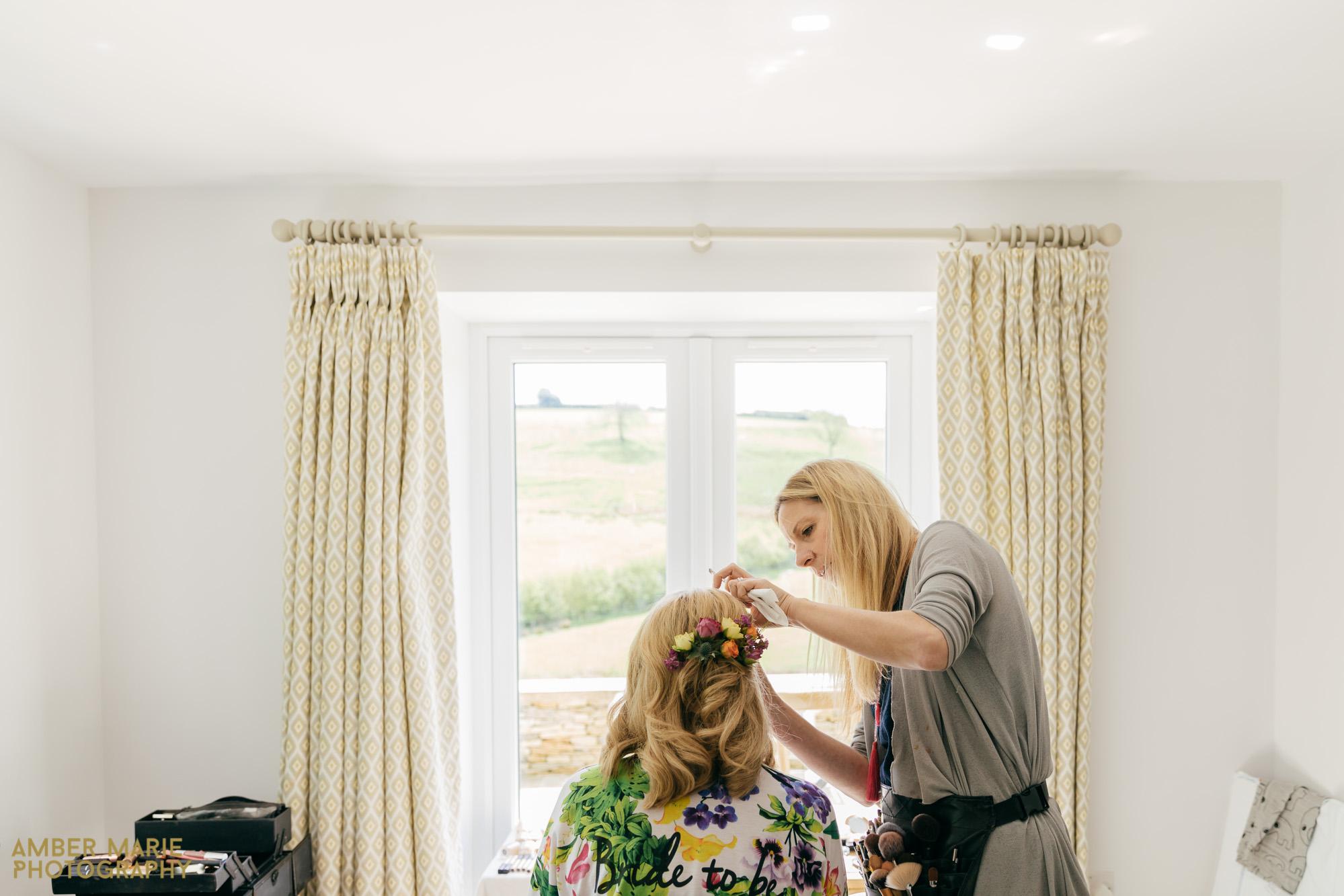 bride getting ready by Kingscote Barn Wedding Photographer