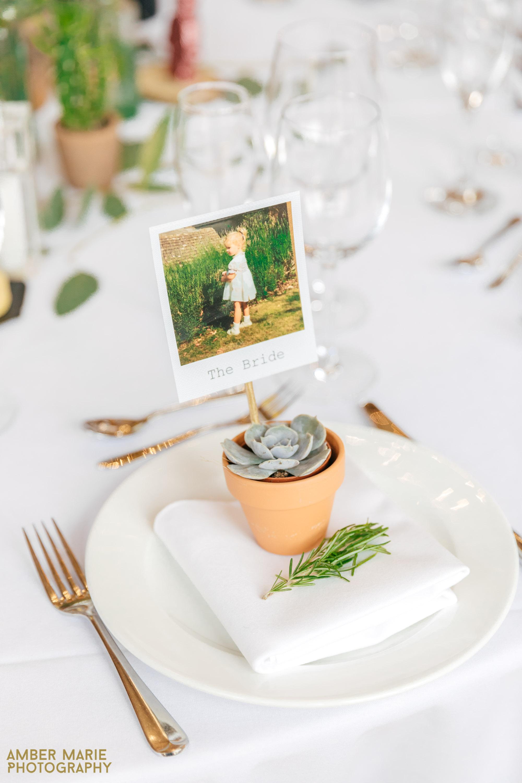 succulent table settings at kingscsote barn wedding