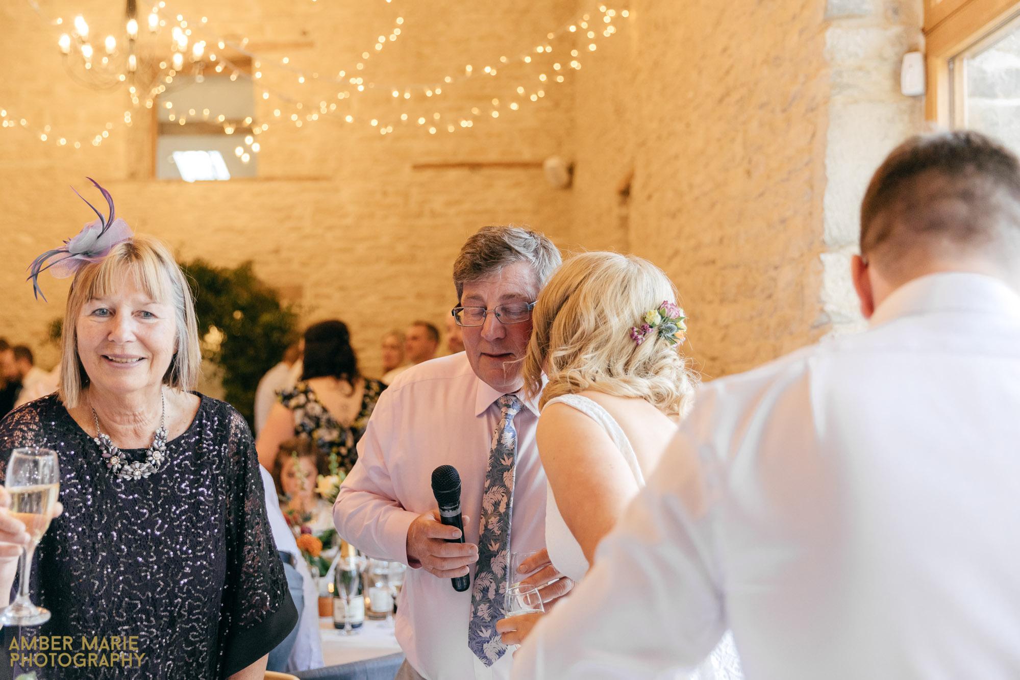 creative wedding photographer kingscote barn