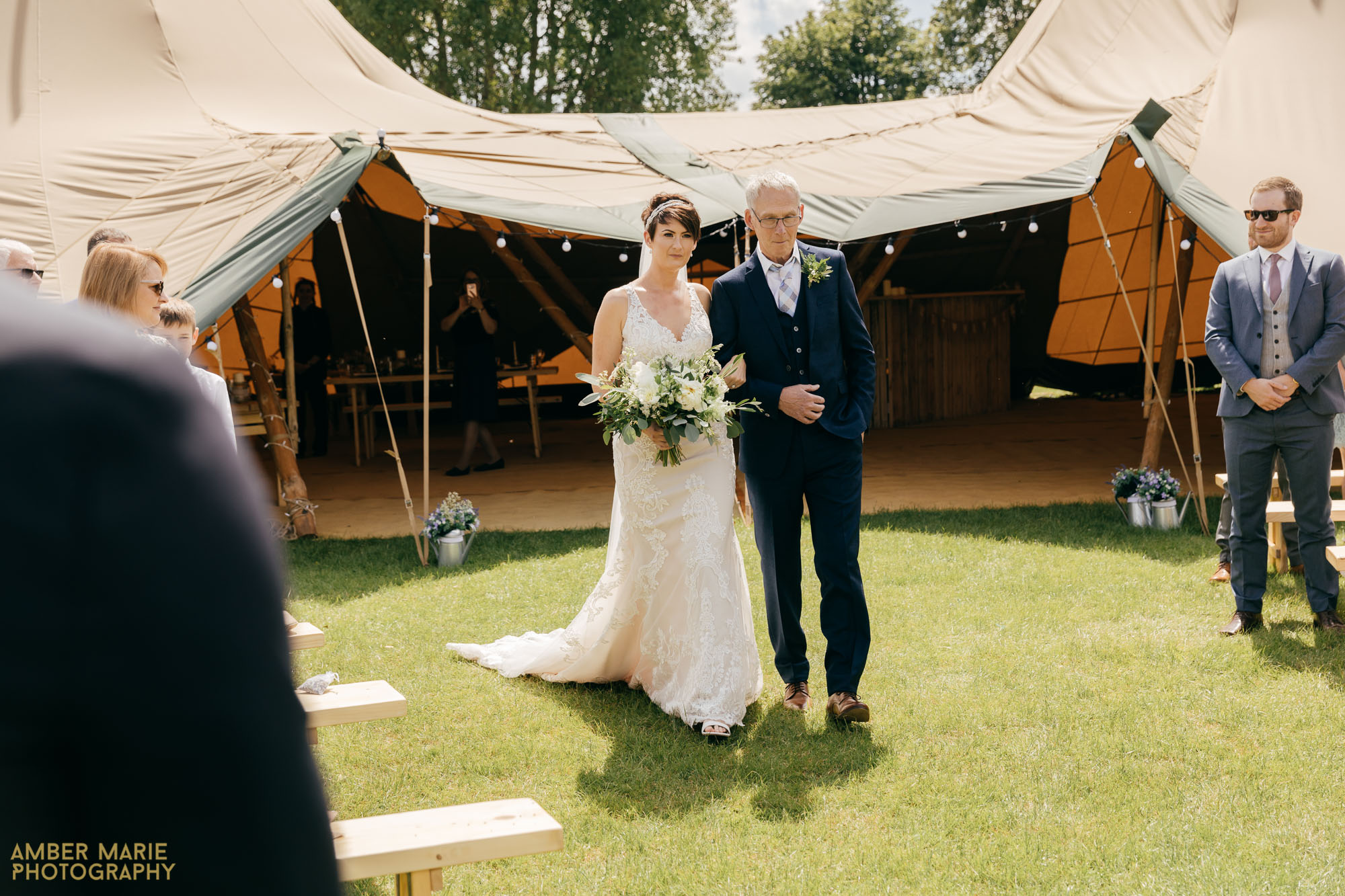 outdoor tipi wedding photography by wedding photographer gloucestershire