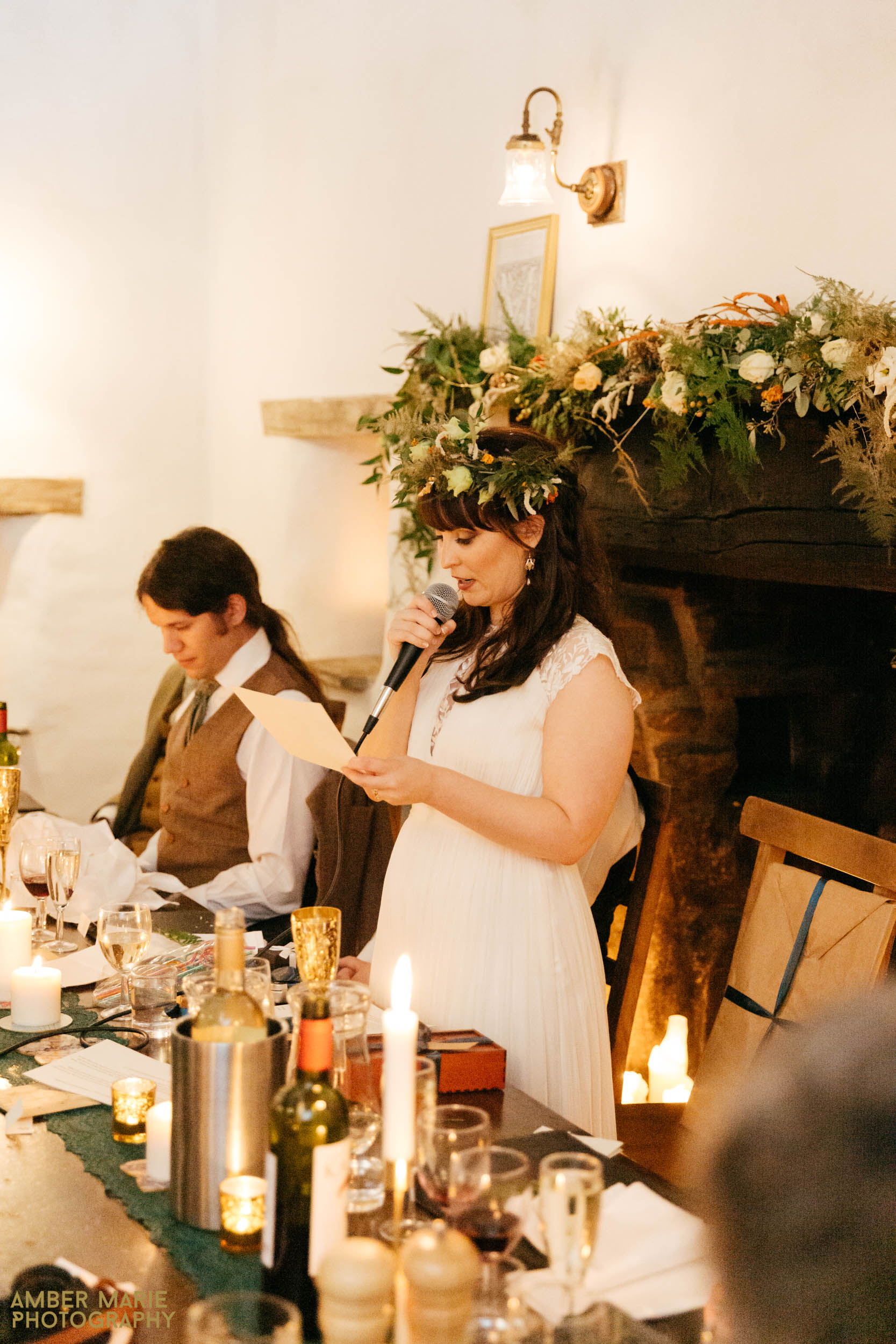 bride giving speech at stylish halloween wedding cotswolds